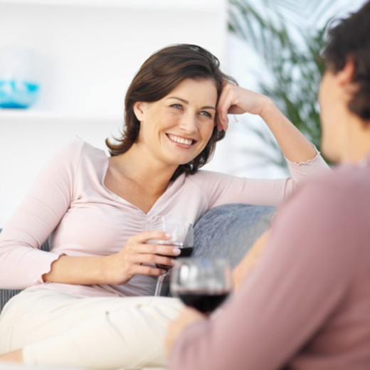 Couple relaxing at home with wine : Stock Photo