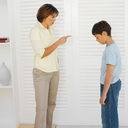 Stock Photo: 1491R-1069230 Mother scolding his son (11-12)