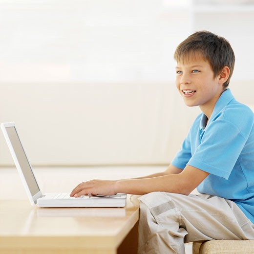Stock Photo: 1491R-1069241 Side view of boy (11-12) working on laptop