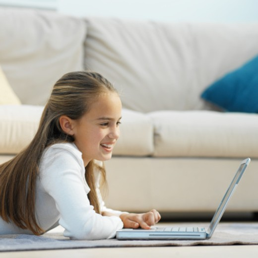 Stock Photo: 1491R-1069334 Side view of girl (11-12) working on laptop