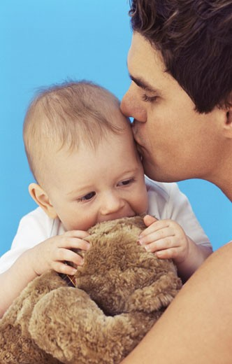 Stock Photo: 1491R-1069633 Close-up of father kissing baby son (6-12 months)
