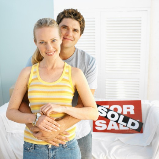 Stock Photo: 1491R-1069803 Delighted couple after buying a house