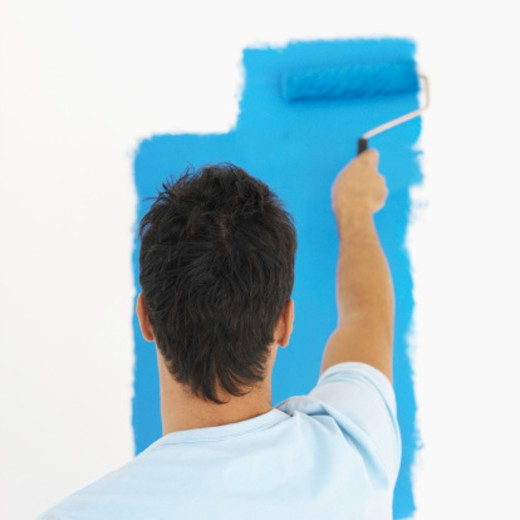 Man painting with a roller : Stock Photo