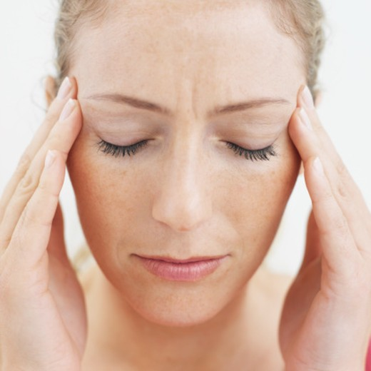 Close-up of mid adult woman touching her face with pain : Stock Photo