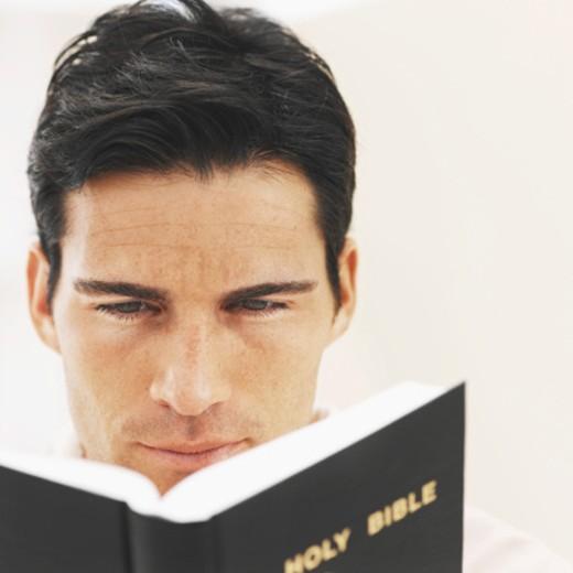 Man reading the bible : Stock Photo