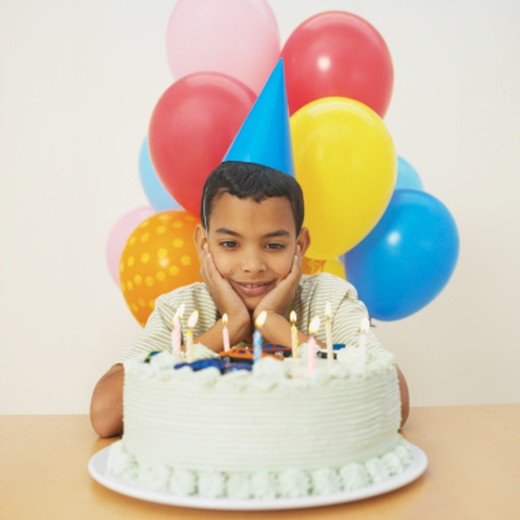 Stock Photo: 1491R-1071629 Boy (9-10) with birthday cake