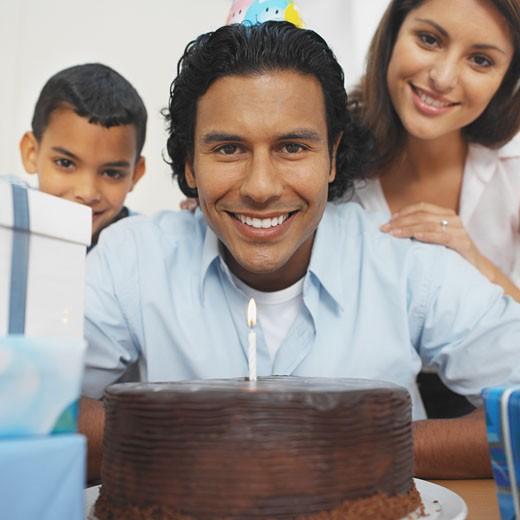 Family celebrating father's birthday : Stock Photo