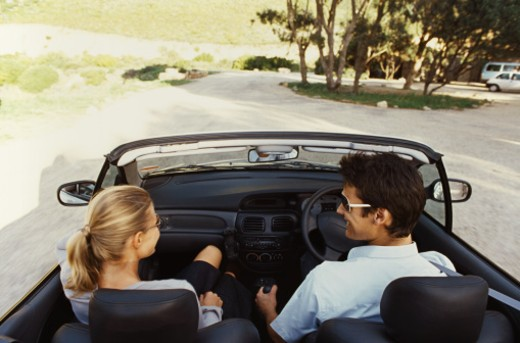 Rear view of young couple traveling in car : Stock Photo