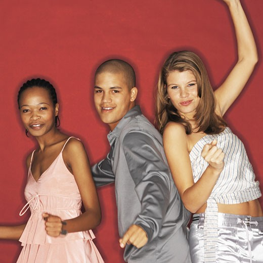 Stock Photo: 1491R-1072018 Front view portrait of three young people dancing
