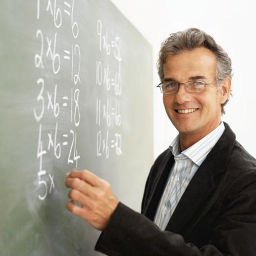 Stock Photo: 1491R-1072069 Close-up of teacher writing mathematics on chalkboard