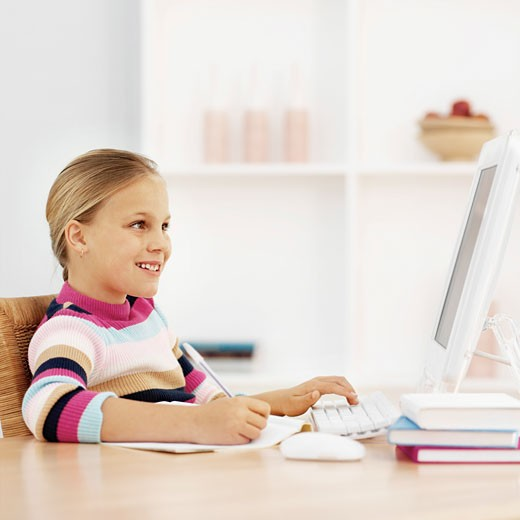 Close-up side view of girl working on computer (10-11) : Stock Photo