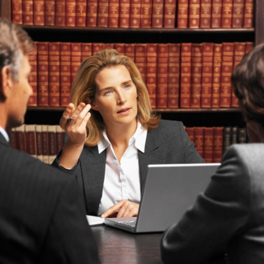 Close-up of three business colleagues having meeting : Stock Photo