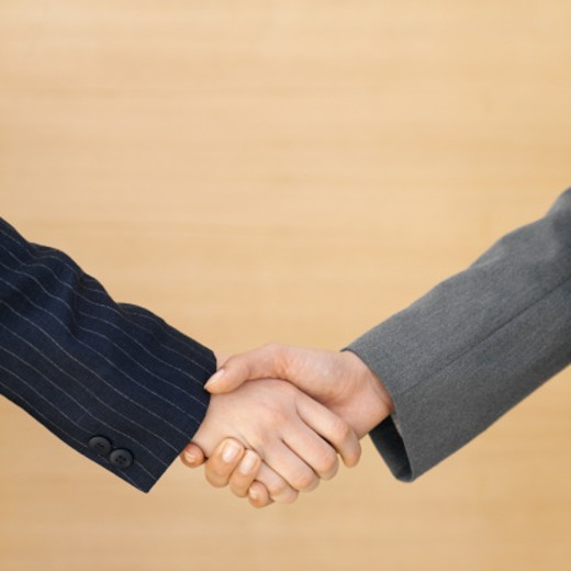 Stock Photo: 1491R-1072374 Close-up of two businesswomen shaking hands