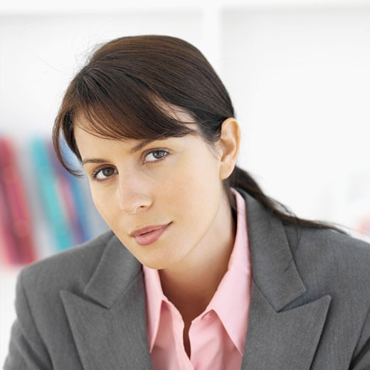 Stock Photo: 1491R-1072381 Close-up front view of businesswoman smiling