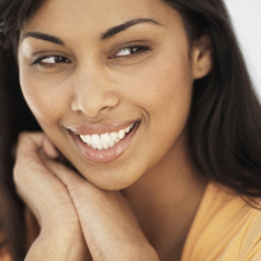 Front view portrait of young woman smiling : Stock Photo