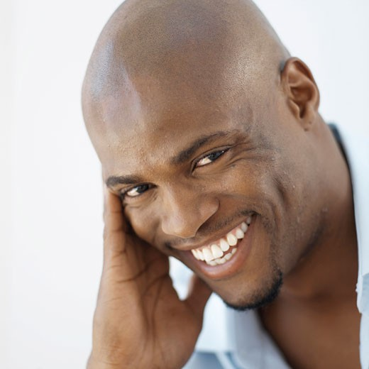 Close-up portrait of young man smiling : Stock Photo