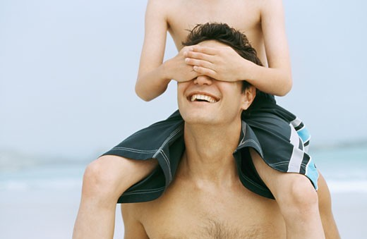 Father with his son (10-11) on his shoulders : Stock Photo