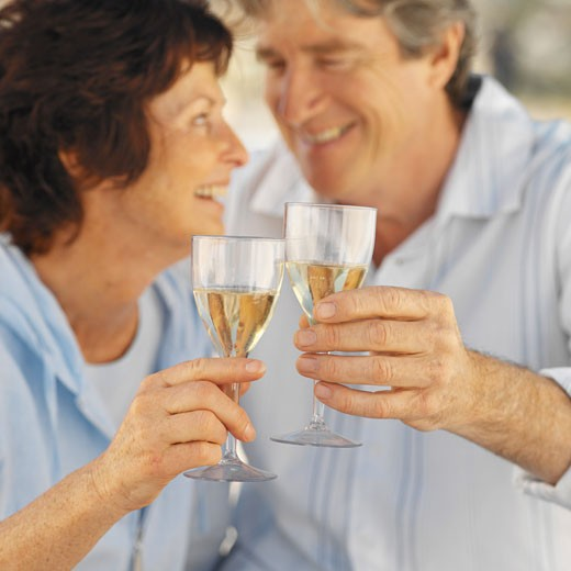 Close-up of mature couple holding glasses of wine : Stock Photo