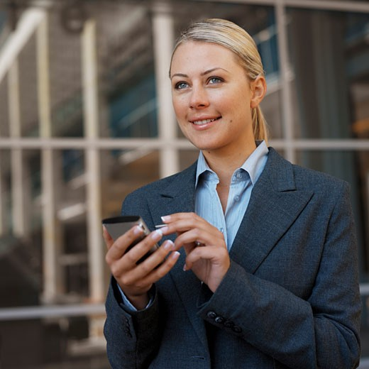 Stock Photo: 1491R-1073414 Businesswoman using a PDA