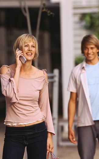 Stock Photo: 1491R-1073553 Young woman talking on a mobile phone