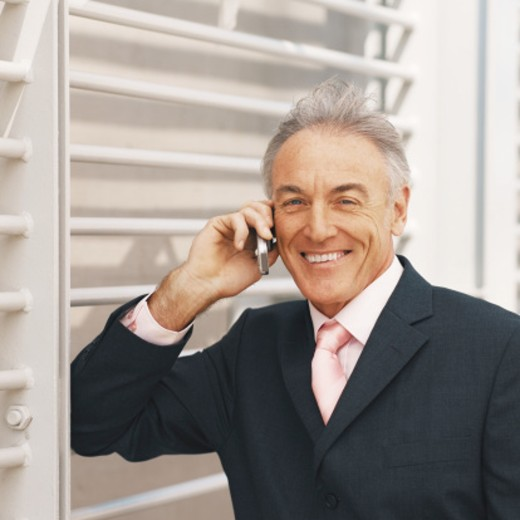 Stock Photo: 1491R-1073581 Businessman on mobile phone