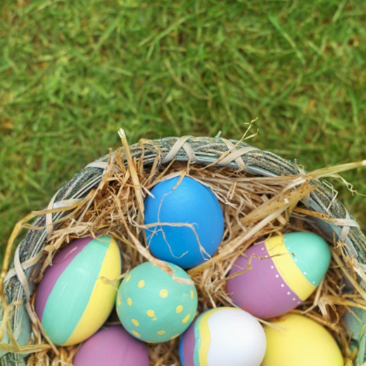 Elevated view of a basket filled with Easter eggs : Stock Photo