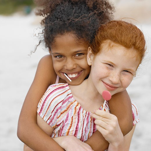 Close-up of two girls hugging (10-11) : Stock Photo