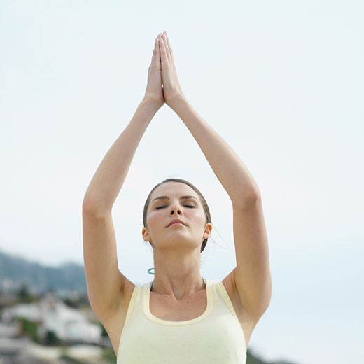 Low angle front view of a woman doing yoga : Stock Photo