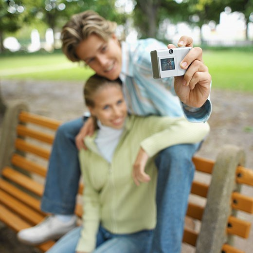 Stock Photo: 1491R-1074206 Couple taking a picture of themselves