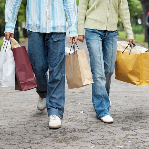 Stock Photo: 1491R-1074212 Low section of a couple carrying shopping bags