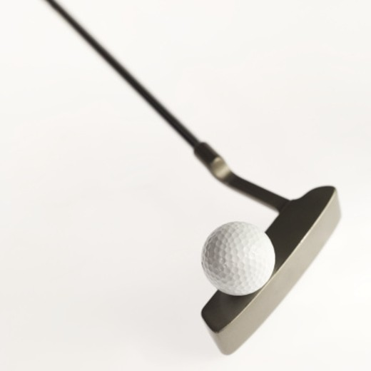 Stock Photo: 1491R-1074634 Close-up of a golf ball and golf club