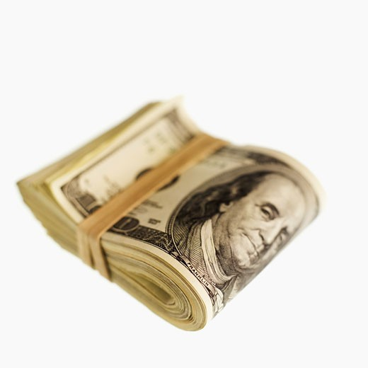 Close-up of American one hundred dollar bills bound with rubber band : Stock Photo
