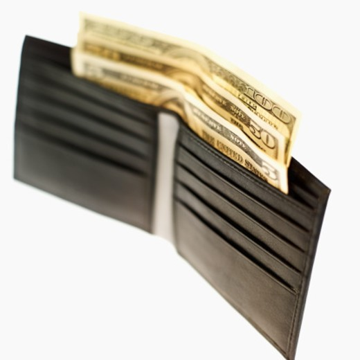 Close-up of wallet containing various American dollar bills : Stock Photo