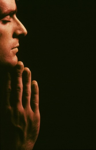 Close-up of a man praying : Stock Photo