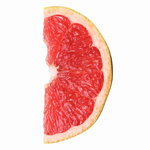 Stock Photo: 1491R-1076179 Close-up of a slice of pink grapefruit