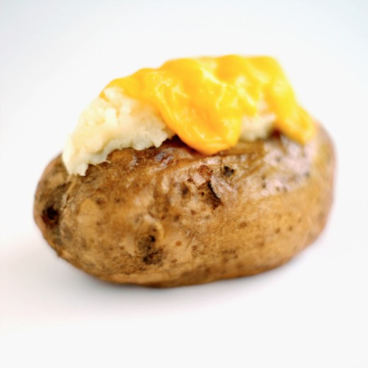 Stock Photo: 1491R-1076752 Close-up of a baked potato with cheese