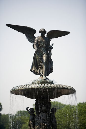 USA, New York City, angel figure on fountain in Central Park, close-up : Stock Photo
