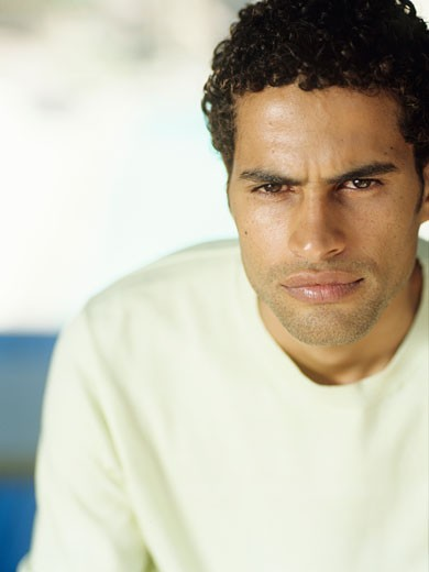 Young man looking away,close-up : Stock Photo