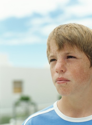 Boy (12-13) outdoors,looking away,close-up : Stock Photo