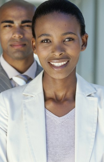 Portrait of business man and woman,man standing behind smiling woman : Stock Photo