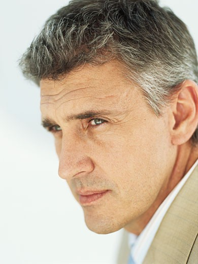 Stock Photo: 1491R-1081016 Mature businessman looking away,close-up