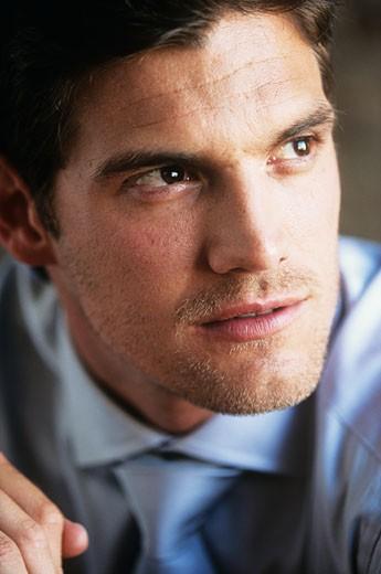 Young businessman looking away,close-up : Stock Photo