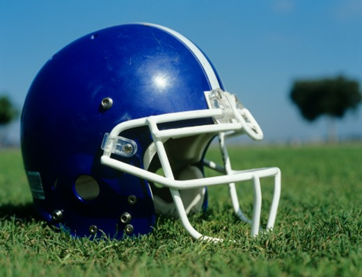 Stock Photo: 1491R-1081778 American football helmet in grass,close-up