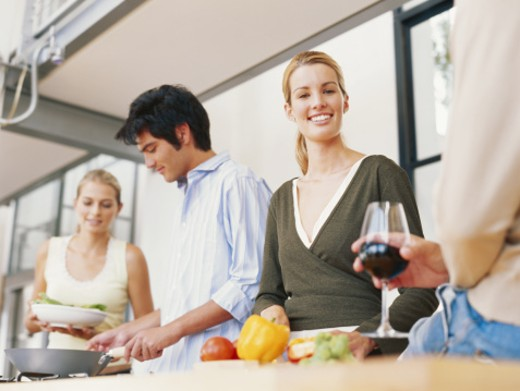 Two young couples in kitchen, low angle view : Stock Photo