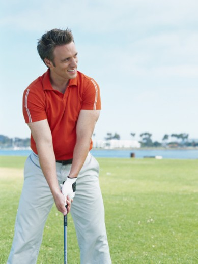 Young man playing golf : Stock Photo