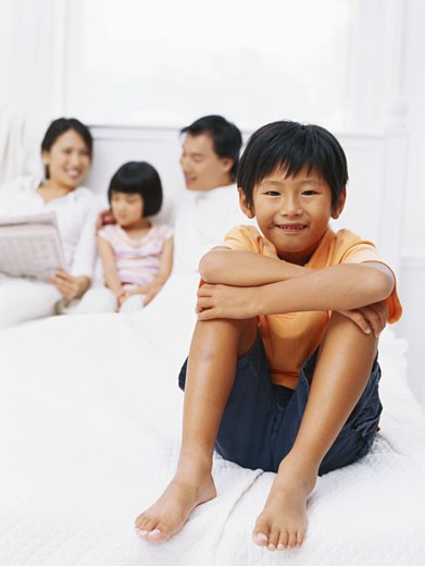 Parents with children (4-7) in bedroom : Stock Photo