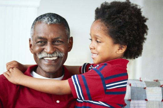 Boy (2-3) embracing grandfather, smiling : Stock Photo