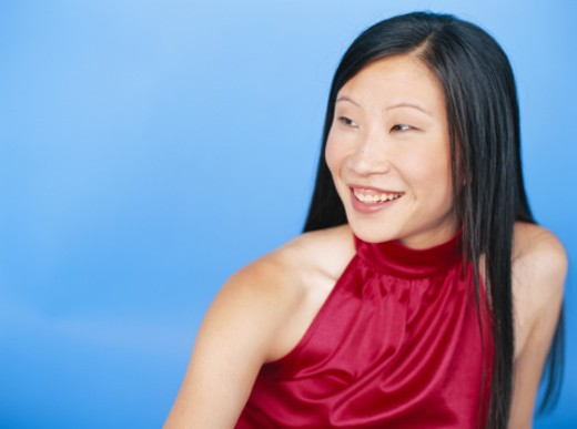 Young woman smiling, looking away : Stock Photo