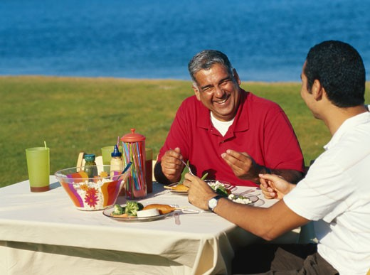 Stock Photo: 1491R-1083760 Father with son sitting at table