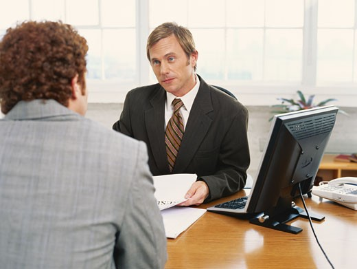 Businessmen having discussion at desk : Stock Photo